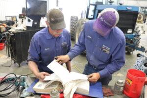 Technicians Byron Biesenthal and Leighton Schaper